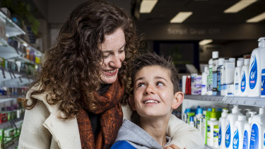 Nickie Williams with son Oliver at the Westgarth Pharmacy, Northcote. The mother welcomes the changes.