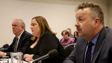 Warren Wilmot (right), the boss of OTR, at a senate inquiry when he was CEO of 7-Eleven.