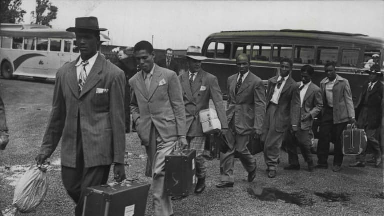 Jamaican immigrants arrive for their first night in London on June 22, 1948.