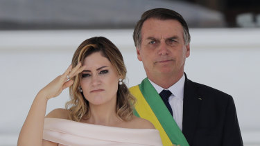 Brazil's new first lady Michelle Bolsonaro, pictured with husband Jair Bolsonaro, gives a military salute from the Planalto Presidential palace, in Brasilia, Brazil, on January 1.