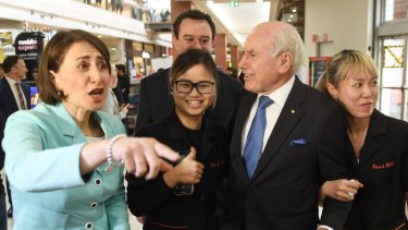 A changing of the guard ... NSW Premier Gladys Berejiklian campaigning with former prime minister John Howard in key battle ground Penrith this week.