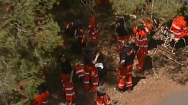 SES crews searching bushland on the Karawatha property for evidence.