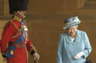 Queen Elizabeth II and Prince Philip prior to The Queen's Company Grenadier Guards ceremonial review at Windsor Castle in 2003. The photographer has revealed what the royal couple was laughing at.