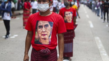 A man wears a T-shirt imprinted with an image of Myanmar's leader Aung San Suu Kyi in July.