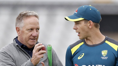 Former Australian wicketkeeper Ian Healy talks tactics with Tim Paine at Old Trafford.