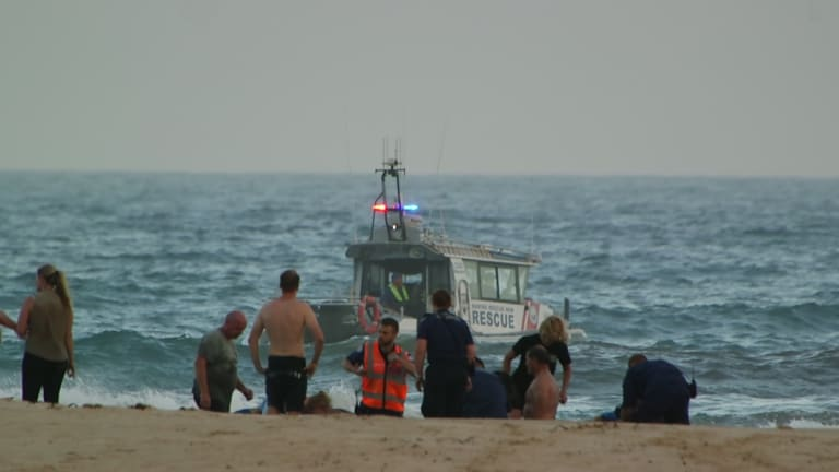 Rescuers tried to save three men after they got into trouble in the water.