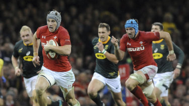 Galloping: Welshman Jonathan Davies makes a break during their victory over South Africa.