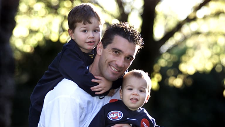 Ben Silvagni (1) with brother Jack (3) and dad Stephen before the latter's 300th game in 2001.