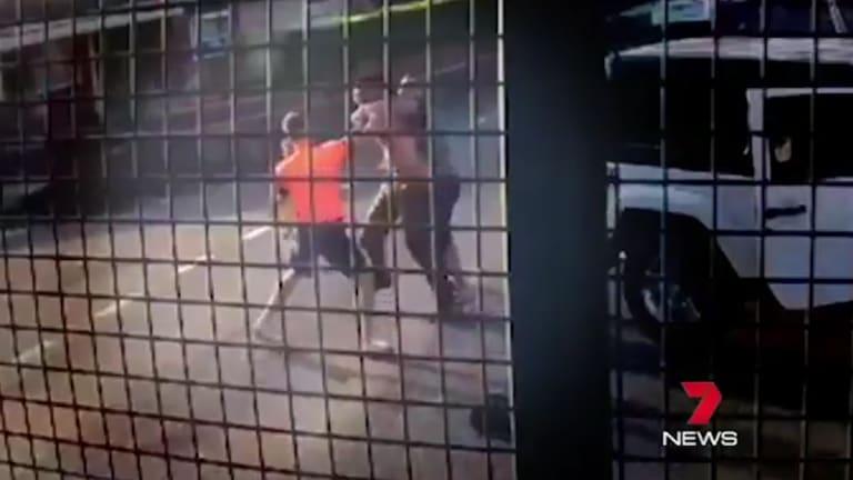 A man in a hi-vis vest runs to the aid of the Jeep driver.