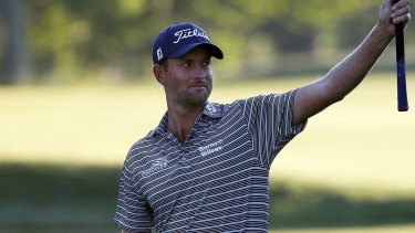 Signing off: Webb Simpson reacts after his eagle on the 18th hole during the second round in Boston.