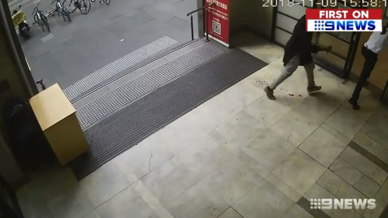 Blood can be seen on the tiles after the security guard is stabbed.