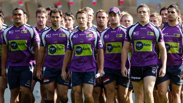 Defiant: Storm players and coach Craig Bellamy front Melbourne's salary cap scandal in 2010.