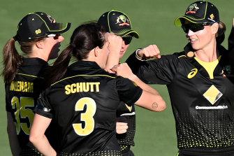 Australia celebrate victory over New Zealand at Allan Border Field on Saturday.