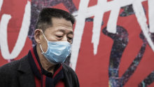 A man wears a face mask in Wuhan, central China, which has been isolated by authorities.