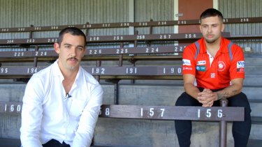 Taylor Walker alongside Robbie Young in an awkward apology video.