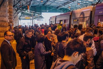 Packed platforms and congested carriages at Central Station in Sydney.