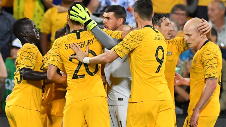 Late show: The Socceroos mob Massimo Luongo after he struck in injury time against South Korea.
