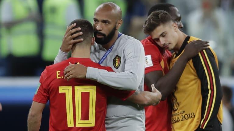 Belgium assistant Henry consoles Eden Hazard after Belgium's semi-final loss at the Cup.