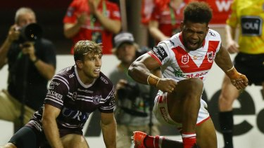 Unstoppable: Mikaele Ravalawa storms across the line for the Dragons.
