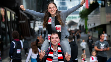 St Kilda fans Jeremy Chait and Bianca Cashmore are thrilled to be back  watching an AFL men's match.