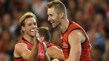 Winning grins: Darcy Parish (left) and Shaun McKernan celebrate after extending the Bombers' lead over the Demons.