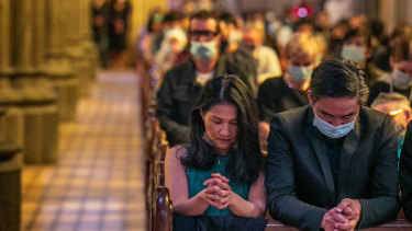 Worshippers at a Christmas service at St Patrick's Cathedral on Friday.