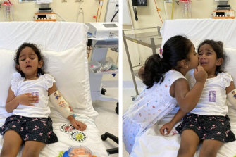 Tharnicaa and her sister Kopika in hospital on Christmas Island on Sunday, June 6.