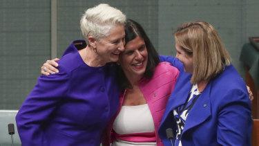 Crossbench MPs Kerryn Phelps, Julia Banks and Rebekha Sharkie celebrate.