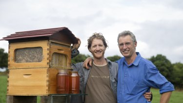 Cedar Anderson and his father Stuart Anderson with their Flow Hive.
