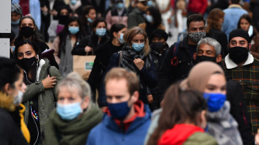Shoppers wear protective face masks on a crowded street in Brussels, Belgium, on Friday, October 16. Belgium trails only the Czech Republic for new cases per capita in Europe.