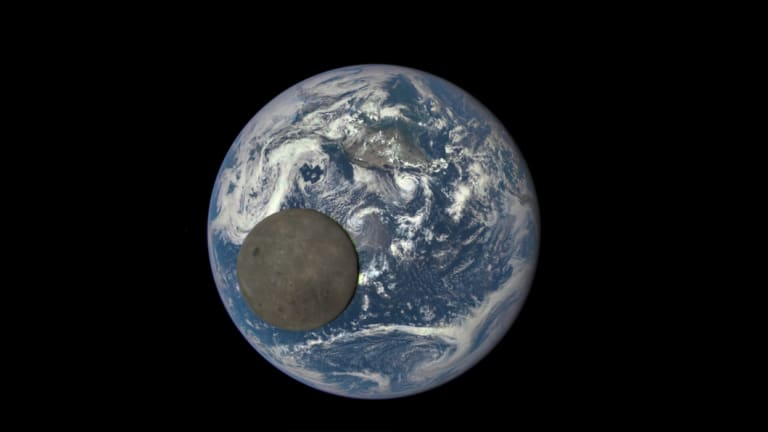 Flat as a pancake: The moon passes in front of the Earth