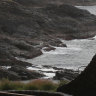 Rock fisherman dies after being swept out to sea at Kiama