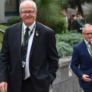 Rohan Brown, at left, and principal Michael Davies on the day Brown returned to the school.