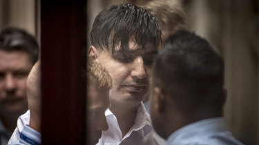 James Gargasoulas is led into court on Friday morning.