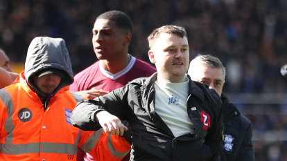 Pitch invader jailed for cowardly attack on Villa captain