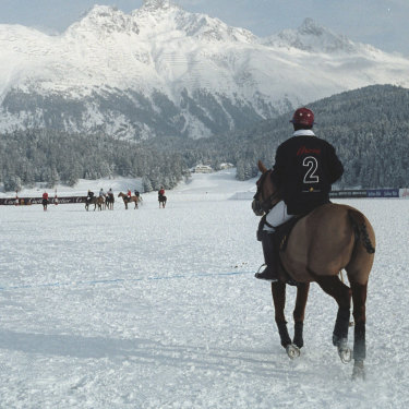 A polo player at the world renowned snow polo tournament on Lake St Moritz, Switzerland.