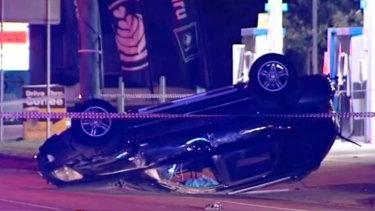 The overturned car near Geelong.