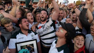Alive and well: Warringah players and fans celebrate their Shute Shield success at the 2017 grand final.