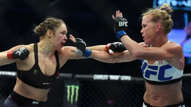 Ronda Rousey (left) fights Holly Holm (right) in the 2015 UFC 193.