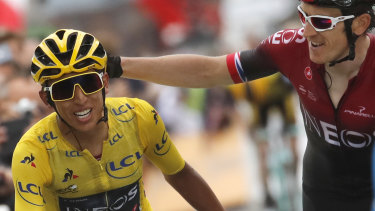 Britain's Geraint Thomas, right, congratulates Colombia's Egan Bernal wearing the overall leader's yellow jersey.