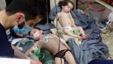 Medical workers treat toddlers following an alleged poison gas attack in the opposition-held town of Douma, in eastern Ghouta, near Damascus, Syria.