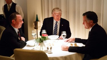 Happier times: then President-elect Donald Trump dines with Mitt Romney and then chief of staff Reince Priebus in November 2016.