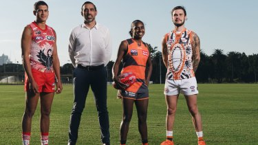 Goodes recently, with James Bell from the Swans, Delma Gisu from the Giants AFLW and Zac Williams from the Giants.