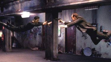 Production has been suspended: Keanu Reeves and Hugo Weaving in science fiction film The Matrix.