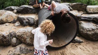 Kids play in the Ian Potter Children's Wild Play Garden in Centennial Park, Sydney.