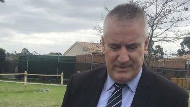 Senior Sergeant Trevor Smith of the Casey Criminal Investigation Unit speaks to reporters.