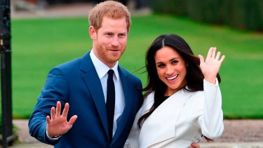 Prince Harry and Meghan Markle pose for the media after their engagement.