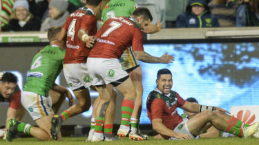 Blues contender: Cody Walker scores out wide for the Rabbitohs.