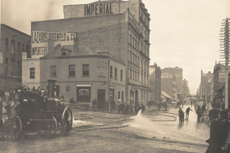 Cleansing the streets in 1900.