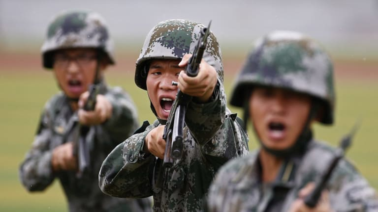People's Liberation Army (PLA) soldiers on display at a tour of an engineering school in Beijing.